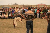 A Mongolian Wrestler performing Devekh dance.