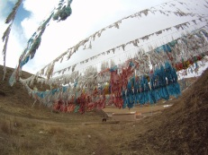 Prayer flags beside the monastery.
