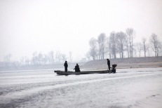 Inside DPRK burdains-- The guard crossing the river