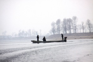 Inside DPRK burdains-- The guard crossing the river