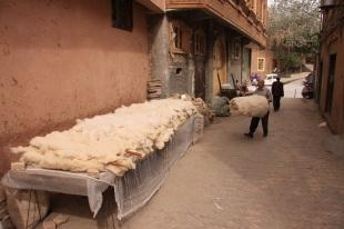 Man preparing cotton mattras