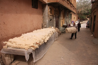 Man preparing cotton mattras
