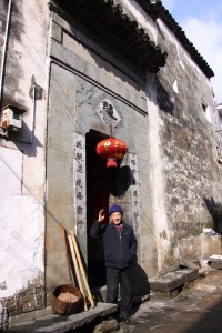 Lao Zhang greeting us from his family house