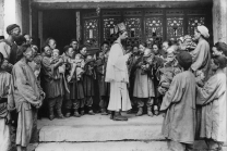 Leone Nani celebrating a baptism of a child